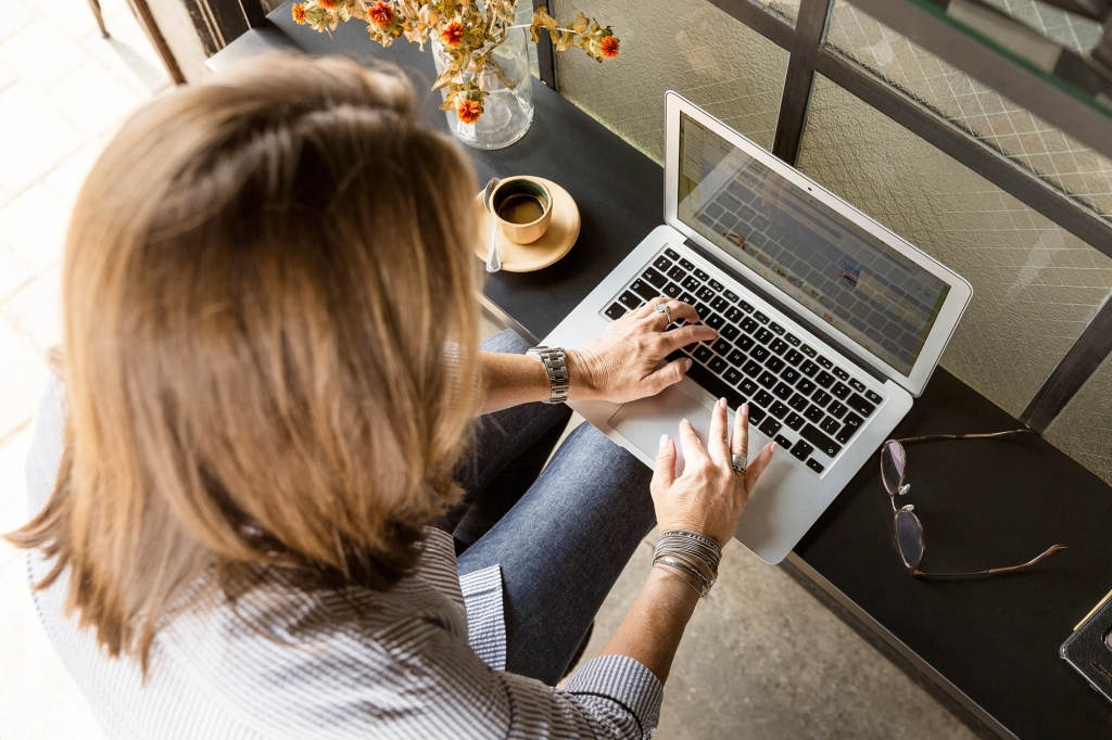 Woman sales person preparing for a meeting with laptop